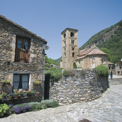 Street in Beget and Romanesque church of Sant Cristòfor