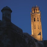 Night-time view of the walls and bell tower of La Seu Vella