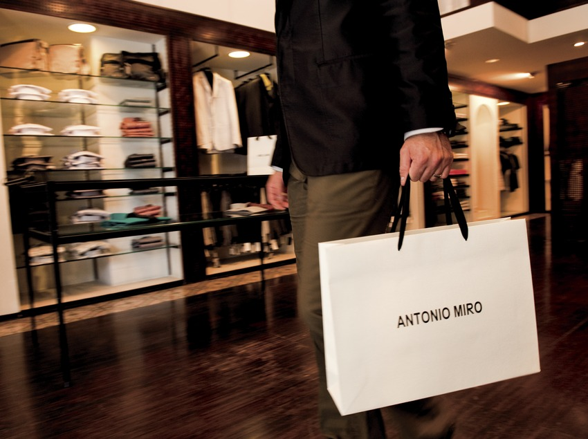 Antonio Miró. A gentleman in the shop with one of the designer's shopping bags