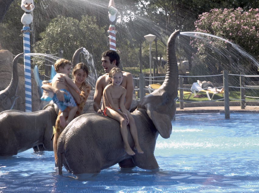 Family in the water park of the Cambrils Park Camping Resort.