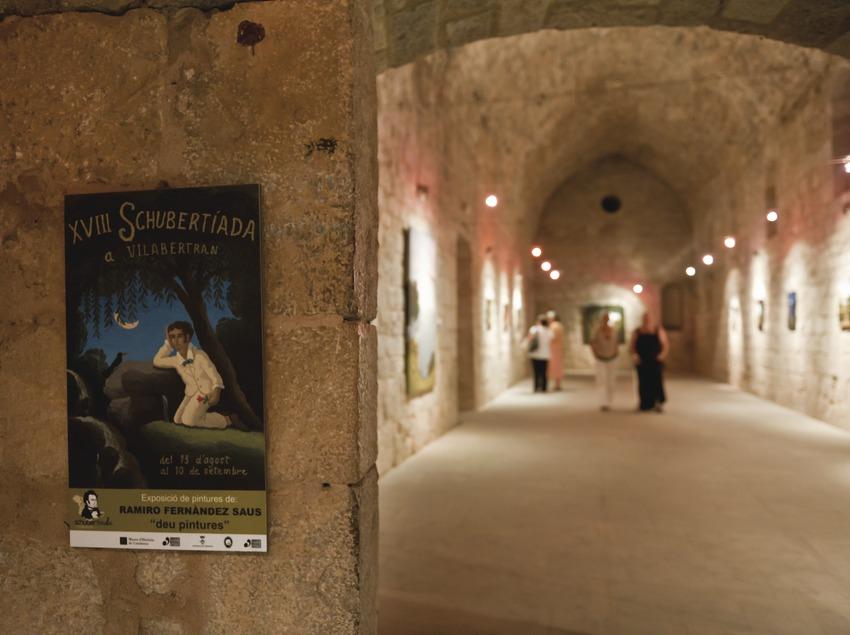 Schubertiada. Església de Santa Maria. Exposició de pintures de Ramiro Fernandez Saus (creador del castell) i cartell del Festival 2010 (Marc Castellet Puig)