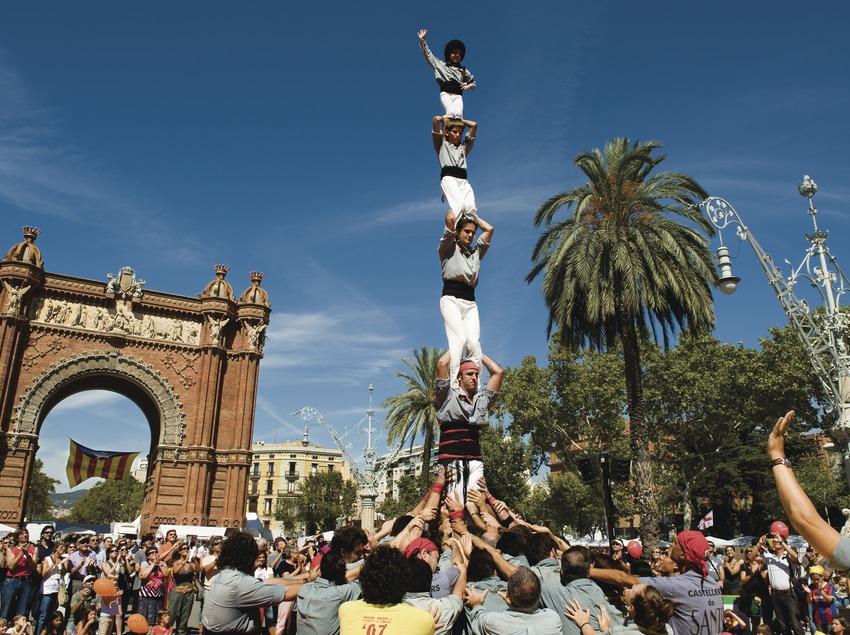 The Castellers de Sants raise a pillar of 5 next to the Arc de Triumf during the Celebration of the Diada Nacional (National Day)