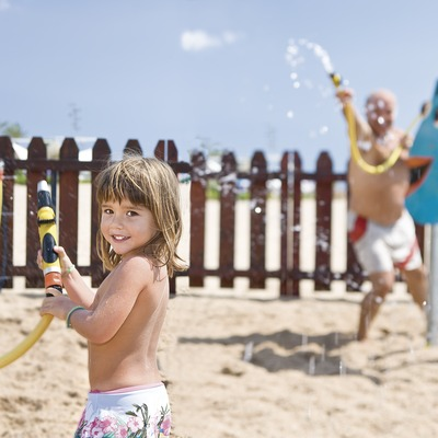 Water game at the children's Club on the beach at Calafell