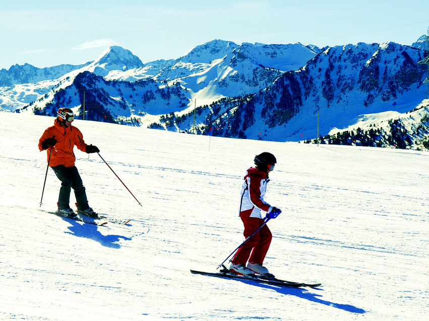 Baqueira Beret. Skiers coming down a ski path