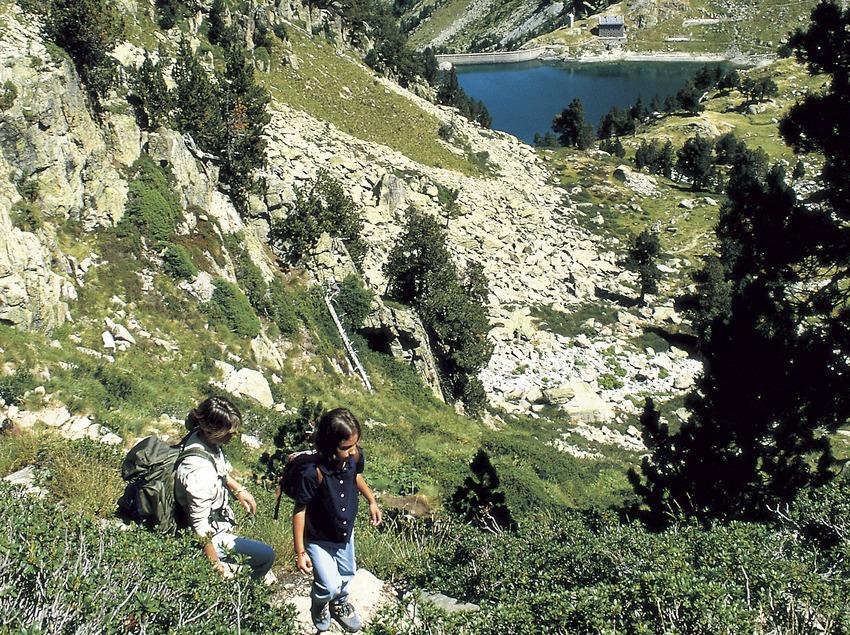 Hikers near La Restanca lake in the Aigüestortes i Estany de Sant Maurici National Park.