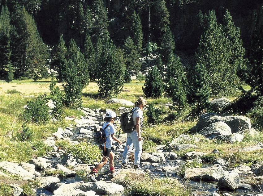 Hikers near Colomers lake in the Aigüestortes i Estany de Sant Maurici National Park.
