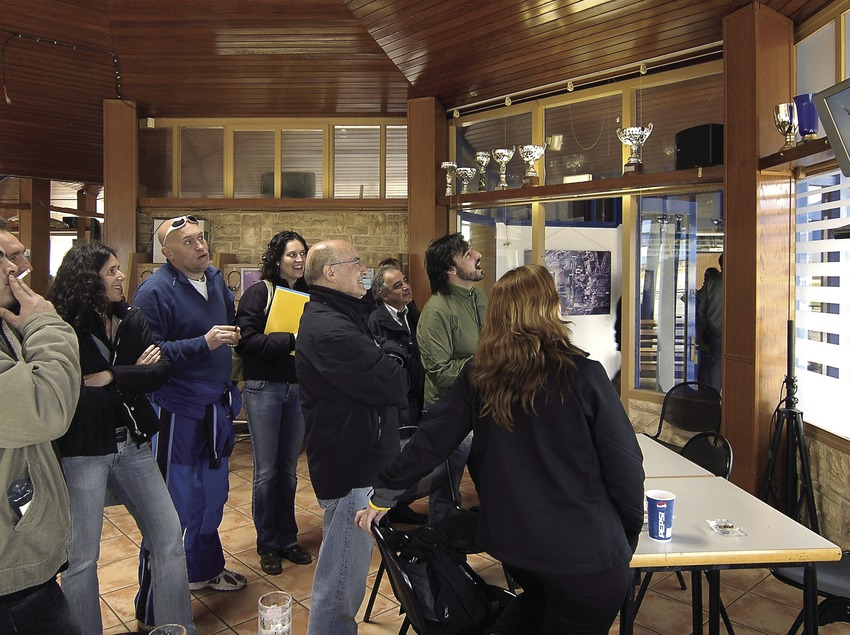 Visitors watching a video of a parachute jump at the Empuriabrava flying club