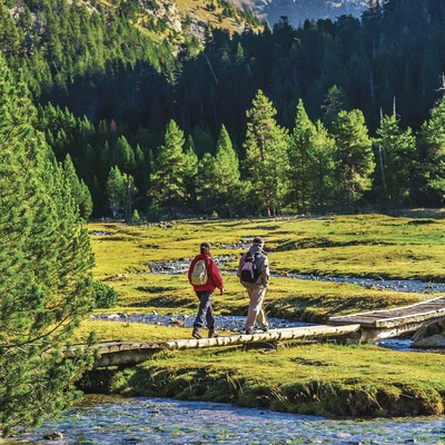 Aiguestortes area. Couple hiking Aiguestortes and Estani de St. Maurici National Park, Pyrenees Mountains. Boi Taull Valley. Alta Ribagorça Region Lerida province. Lleida province Cataluña. Catalunya. Catalonia. Spain