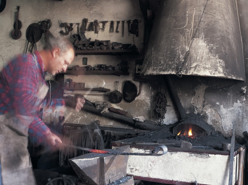 Blacksmith in a forge  (Kim Castells)