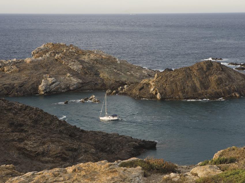 Boat in a cove in the Cap de Creus Natural Park.