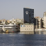 Dock in the Port Vell, with the Barceloneta quarter in the background