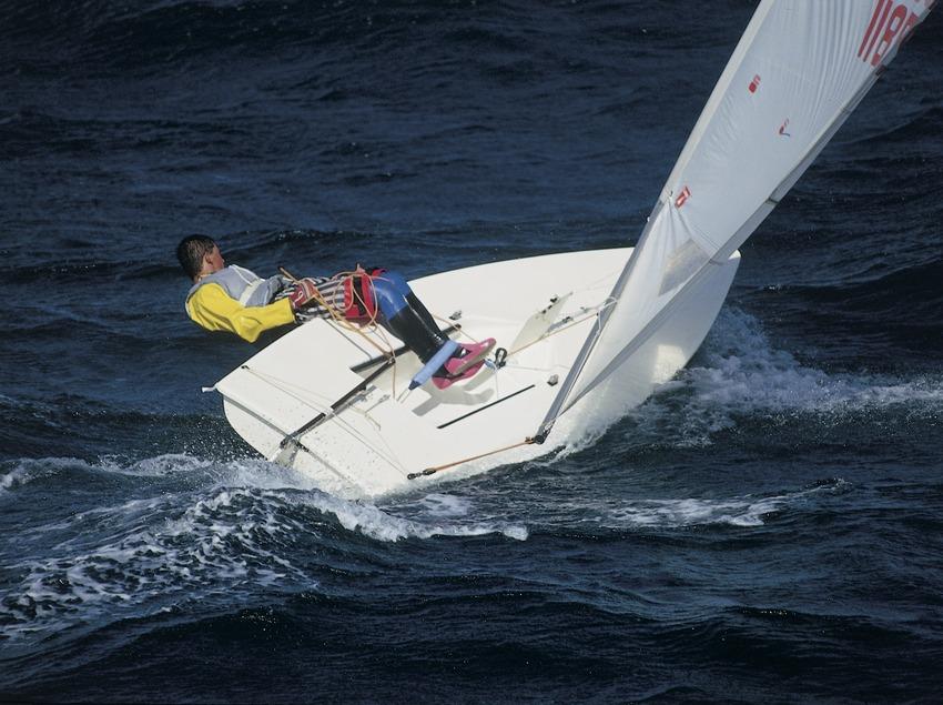 Sailing dinghy (Laser class) in a regatta