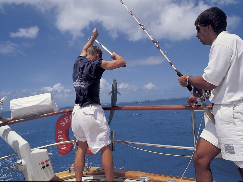 Fishing from a sailing boat off the Costa Brava coast