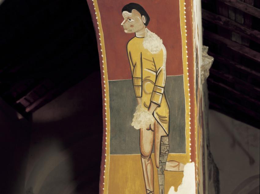 Figura profana (segle XII) a l'intradós de l'església de Sant Joan de Boí.  (Imagen M.A.S.)