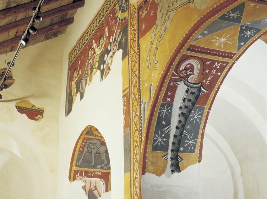 Figura animal fantàstica (segle XII) a l'intradós de l'església de Sant Joan de Boí.  (Imagen M.A.S.)