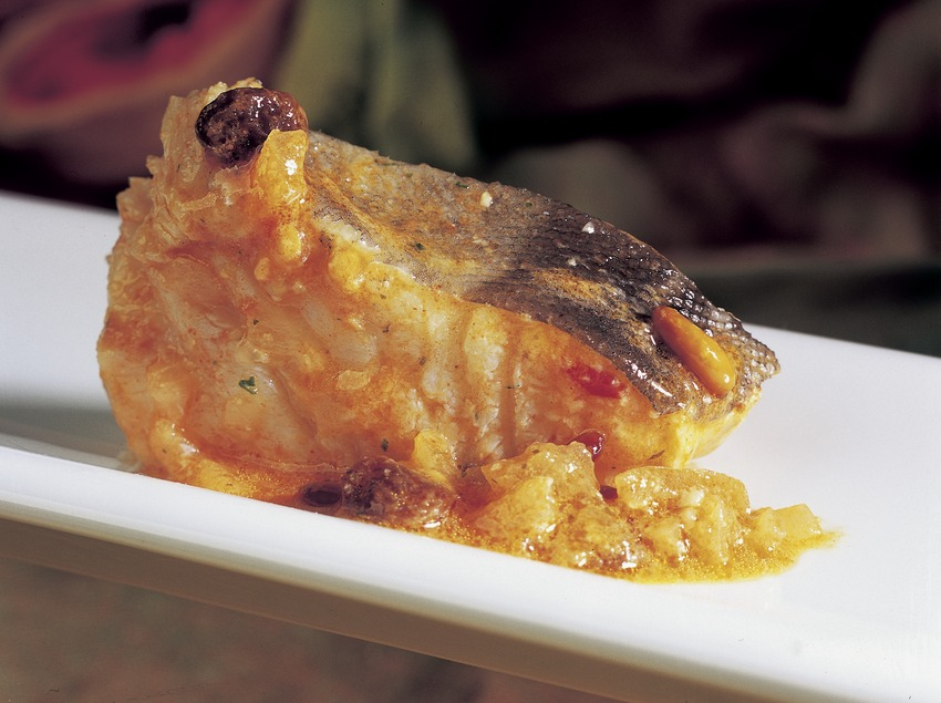 Cod with raisins and pine nuts.