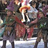 Costumed street entourage during the Sitges Carnival