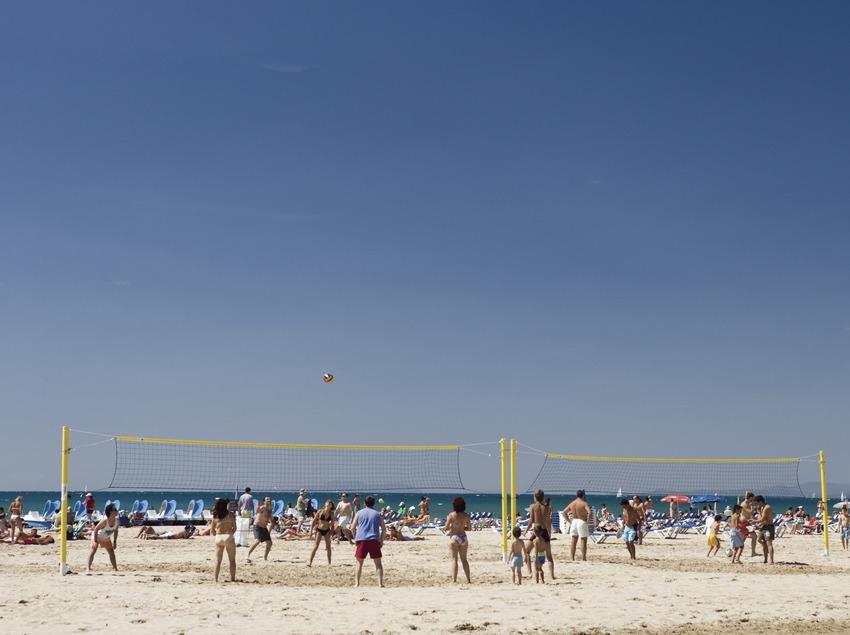 Beach volleyball game.