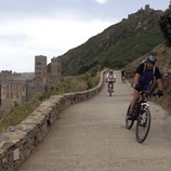 Cyclists near the Sant Pere de Rodes monastery in the Cap de Creus Natural Park